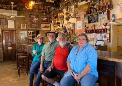 Having a quiet beer at the Birdsville Pub. Note Dick Lang's cap on the wall above Eric's head