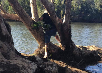 Eric going for that unusual croc shot! — at Kalpower Camping Ground