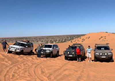 Drivers and their vehicles on top of Big red — at Big Red Sand Dune