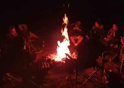 Around the campfire with our tour scarves — at Sandstone Park, Carnarvon Gorge, Qld