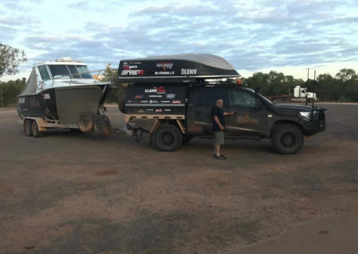 """JW mistaking this for his Ranger. The All 4 Adventure crew with their """"tinny"""" about to empty the roadhouse fuel tanks — at Musgrave Roadhouse, Qld"""